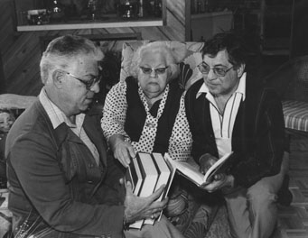 Jack, Samuel and Rae Price look at books